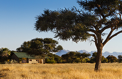 The Ondekaremba Lodge, surrounded by the African bush savannah.